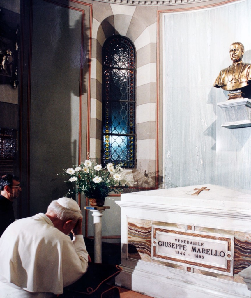 Bl. John Paul II prays at the tomb of St. Joseph Marello in Asti, Italy.